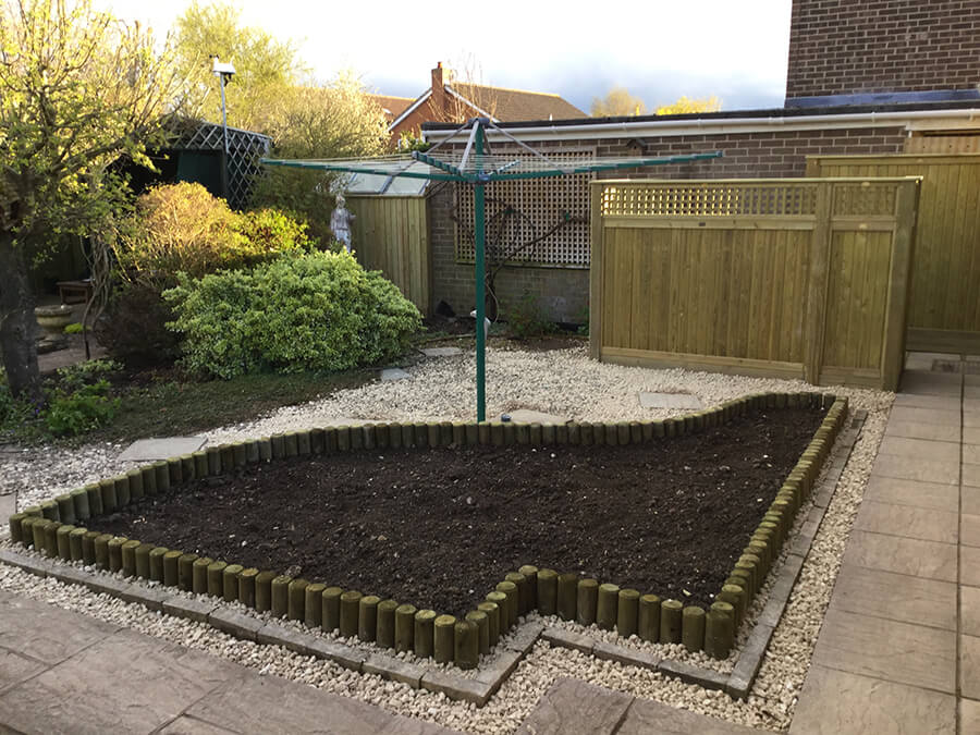 Fencing stakes create planting beds