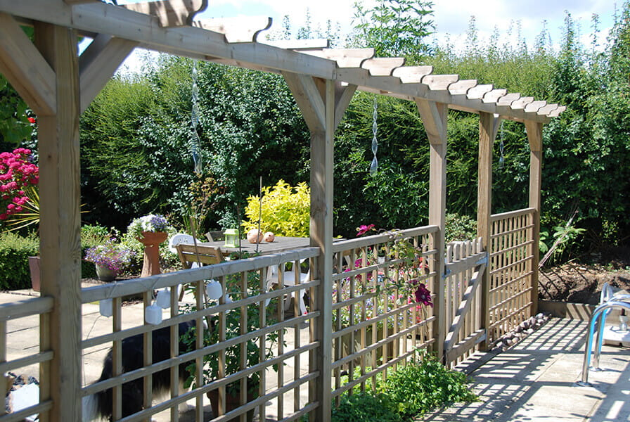 Featherboard with square trellis toppers family garden