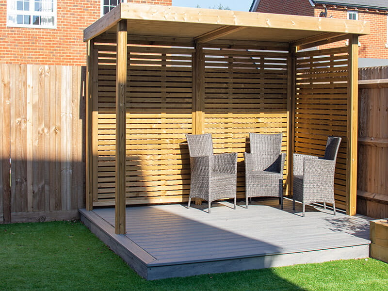 slatted wooden garden shelter
