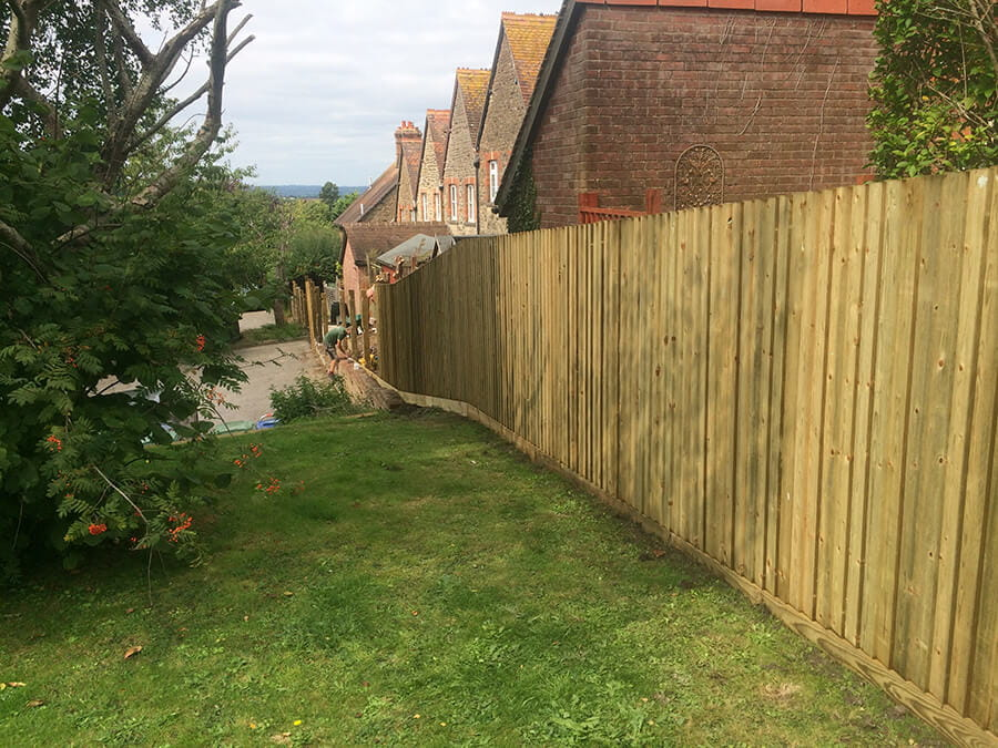 Traditional featherboard garden fence