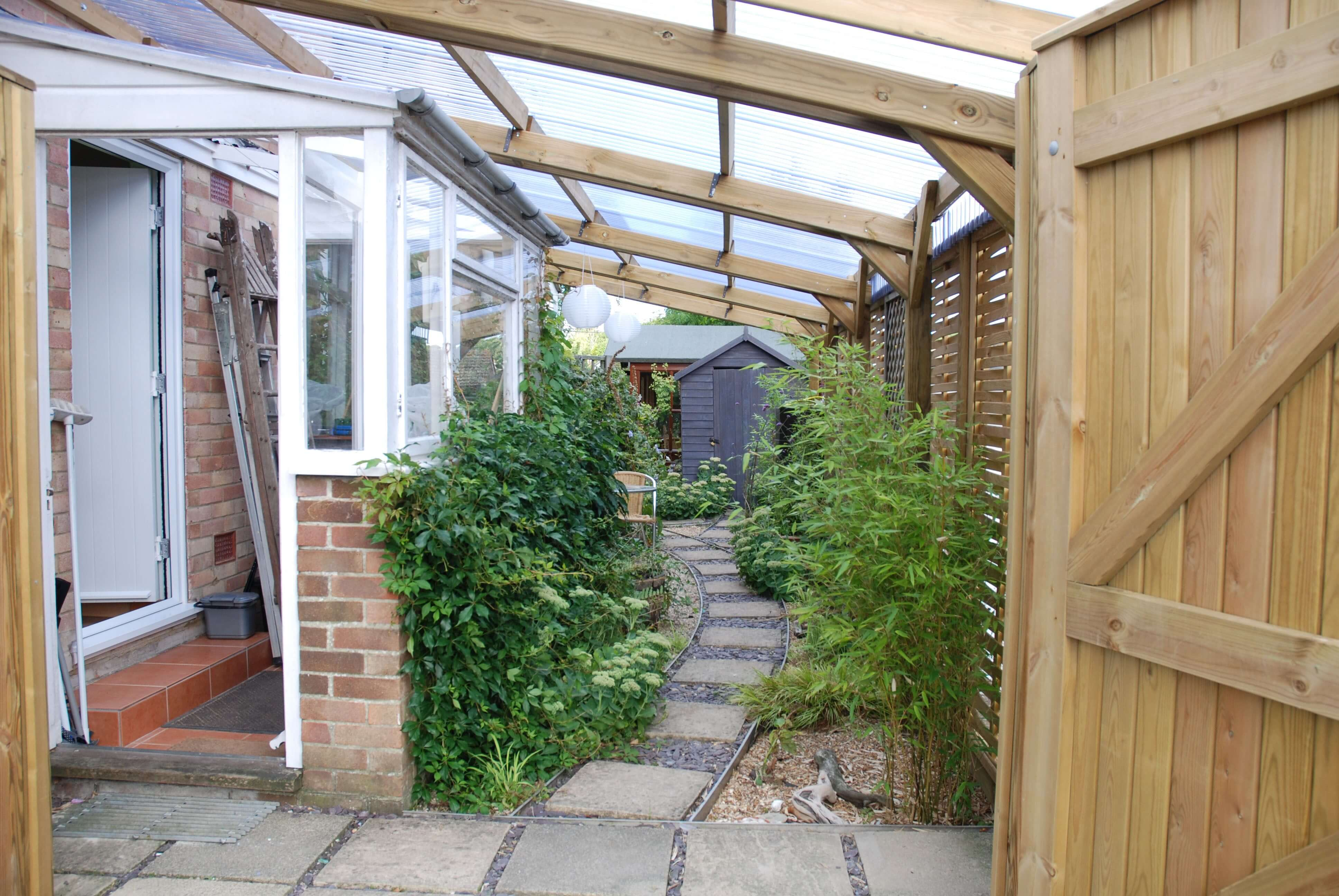 Pergola with plastic roofing on Woven fencing