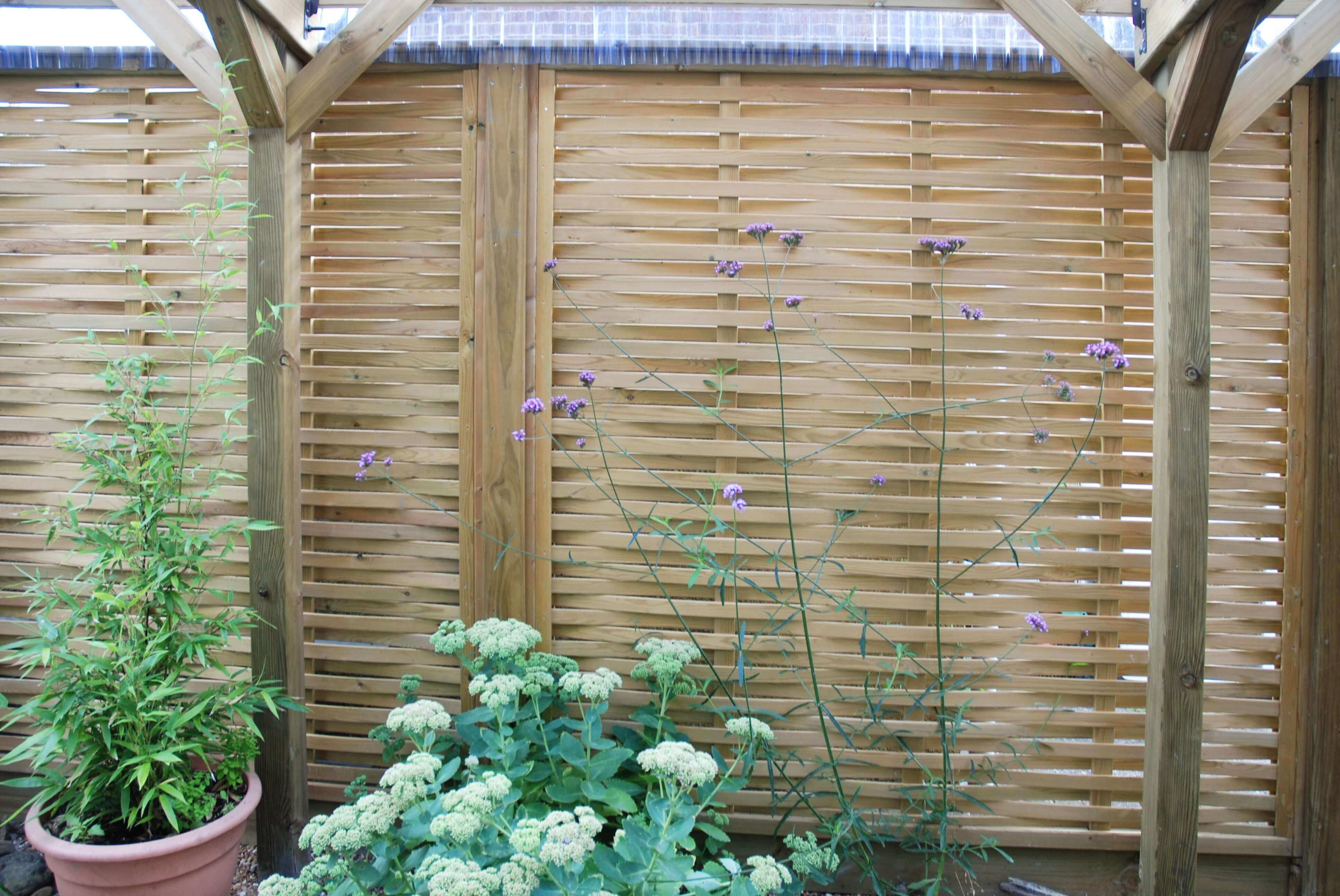 Woven fence panels along room side