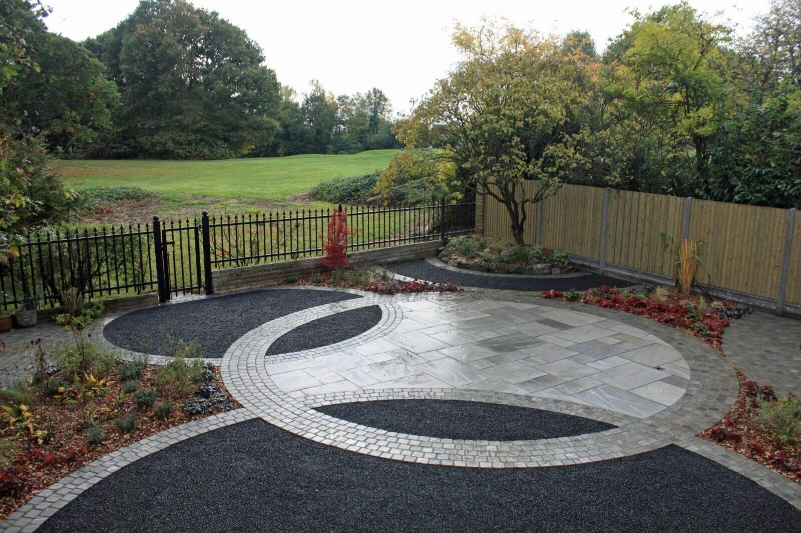 front garden view of basalt paving and fencing