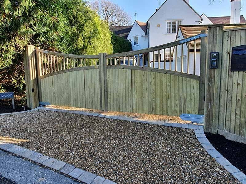 Custom wooden driveway gates bring ideal garden design to life