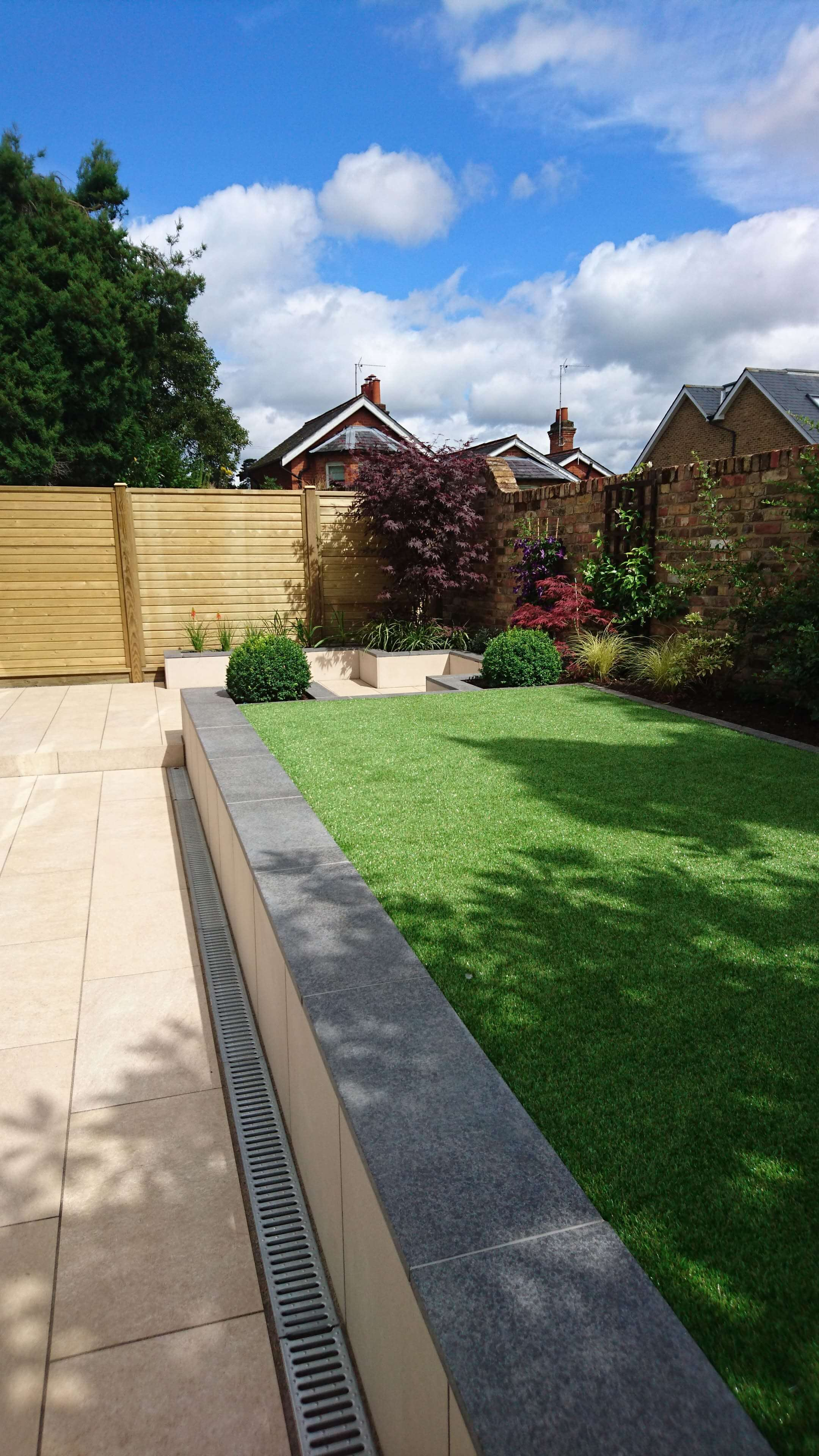 Contemporary Tongue and groove fencing panels with boards running horizontally