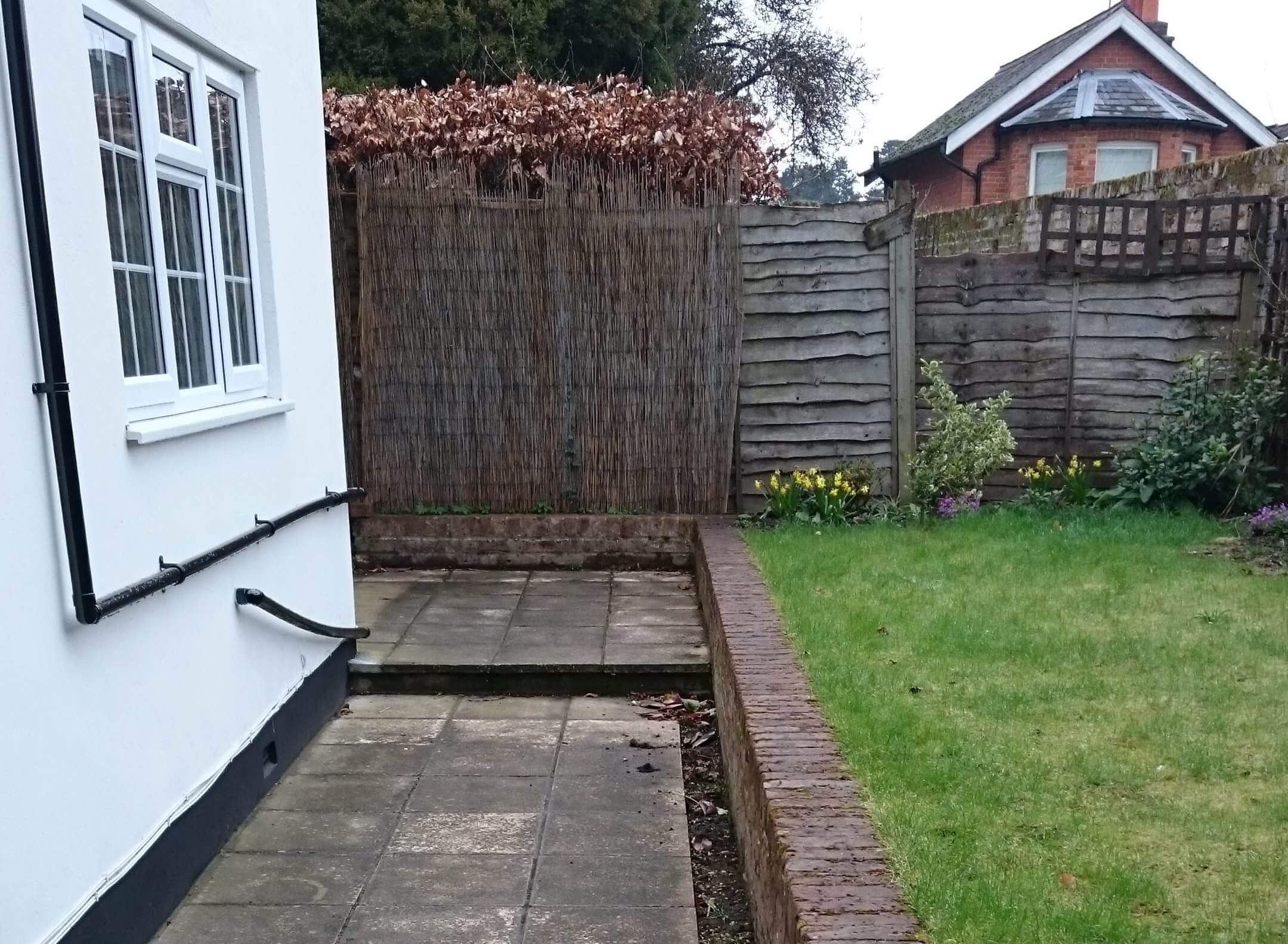 Old lap panel fence and timber screen
