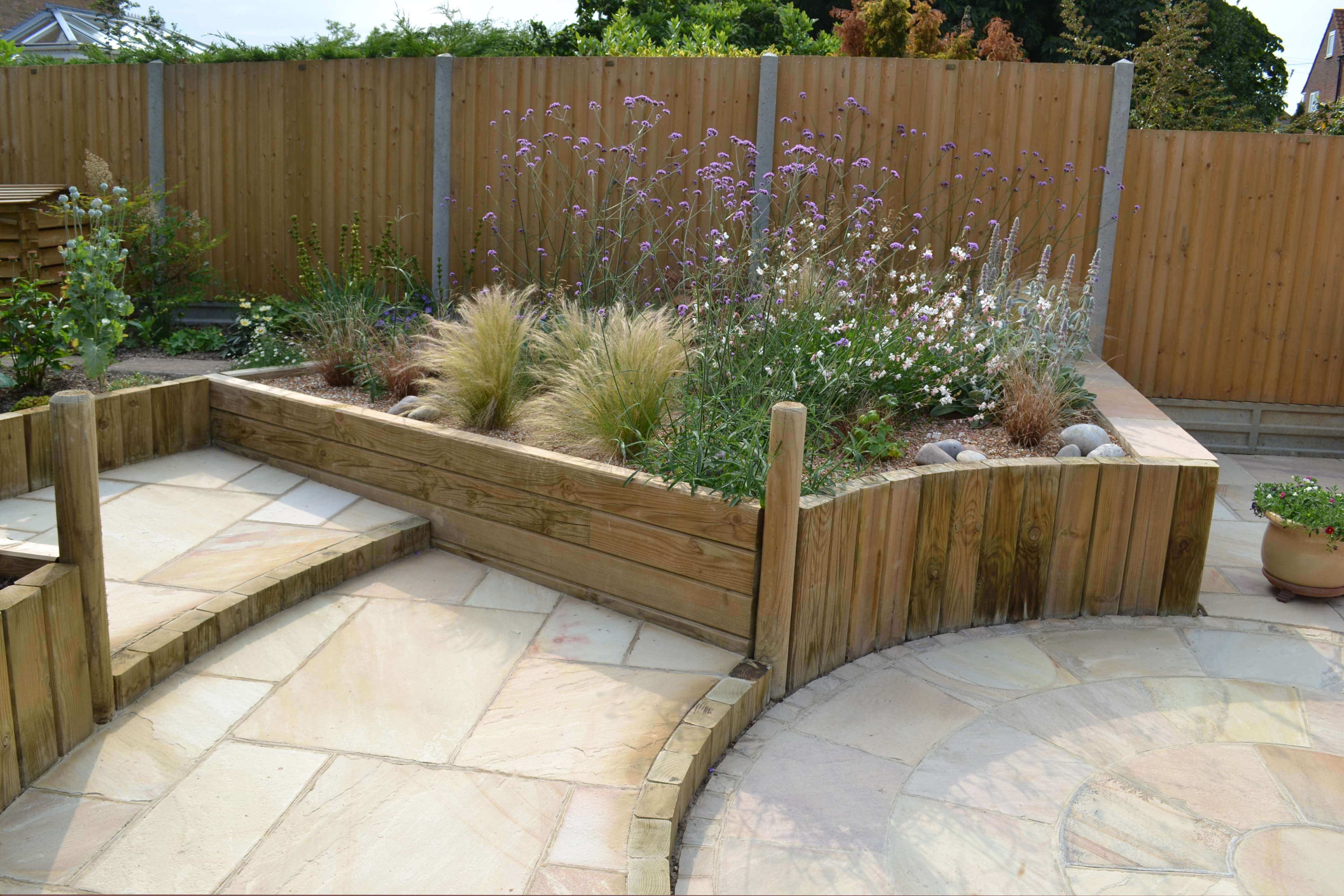 paving with jakwall retaining timber wall