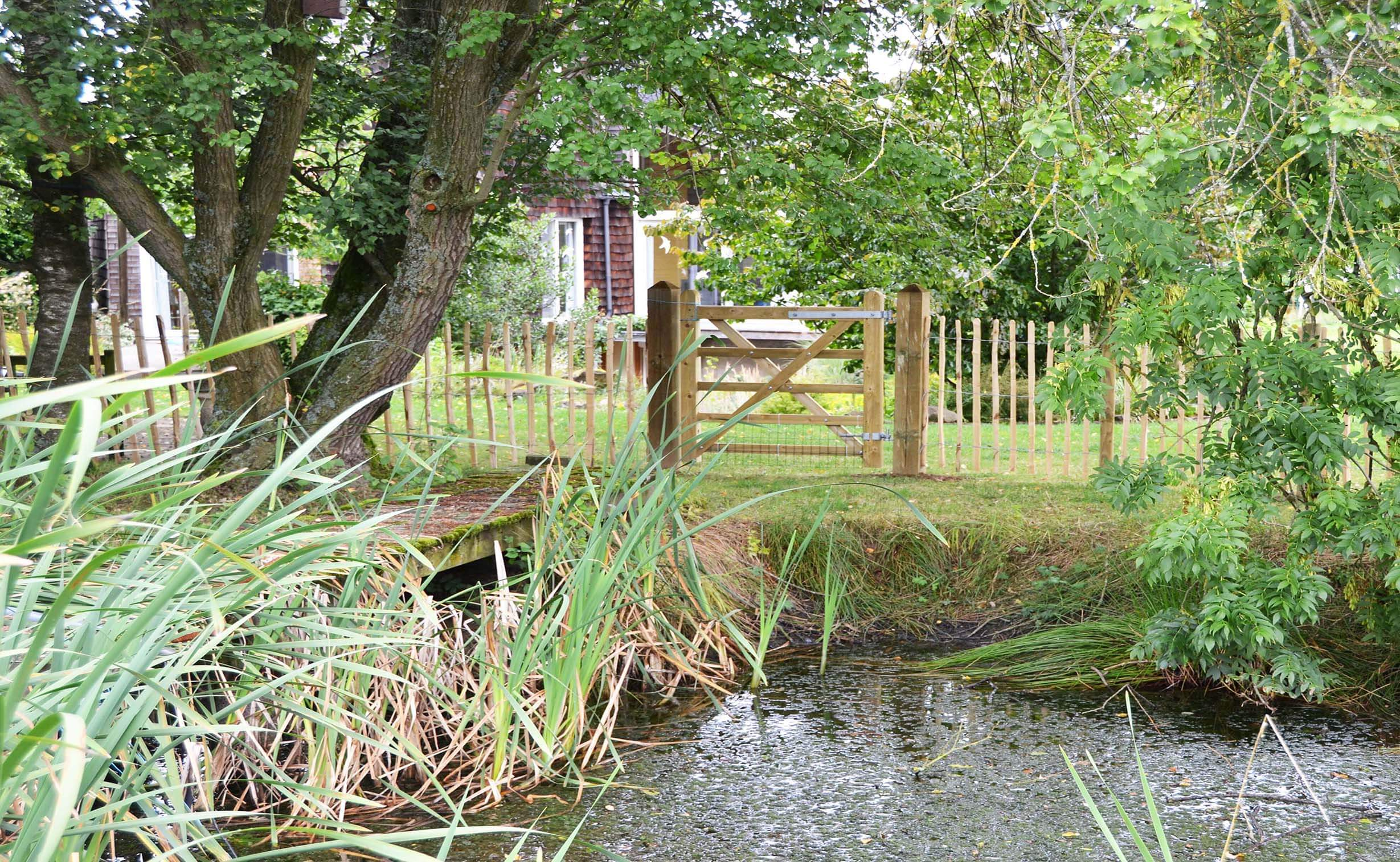 single wooden gate with pond