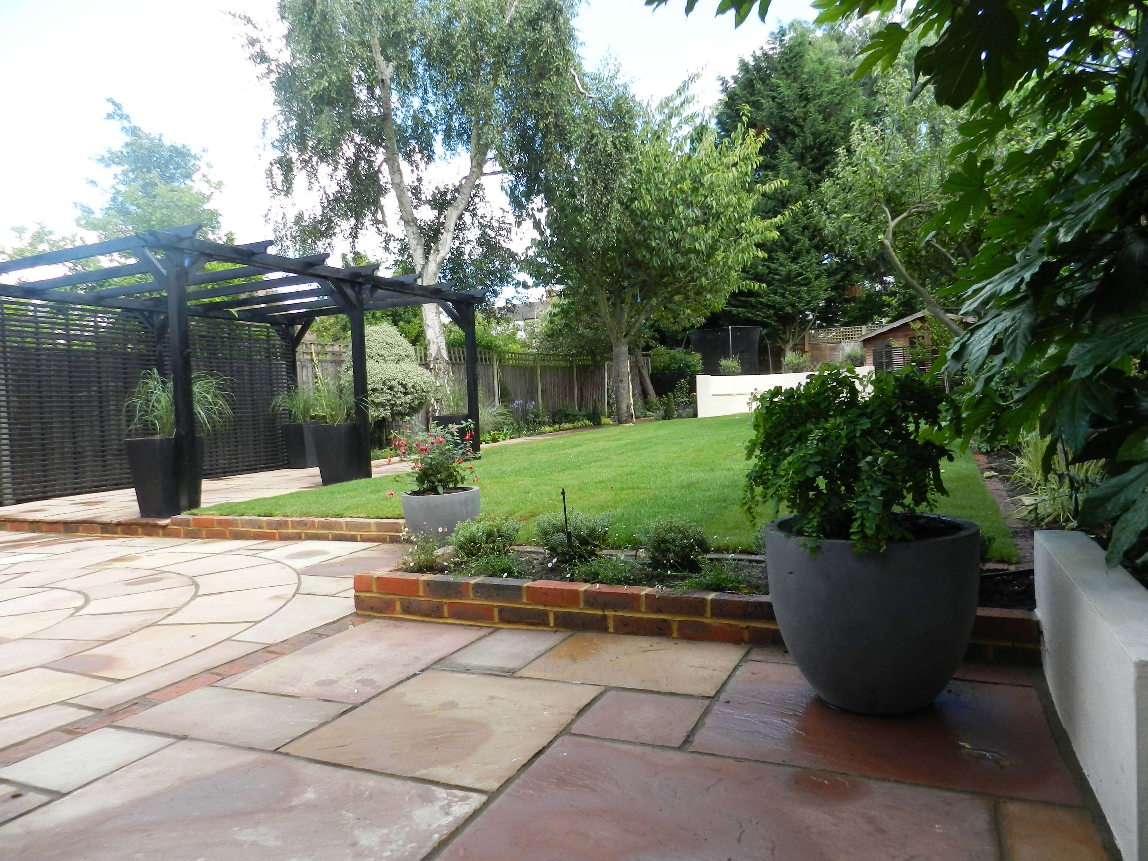 finished garden with timber pergola painted black