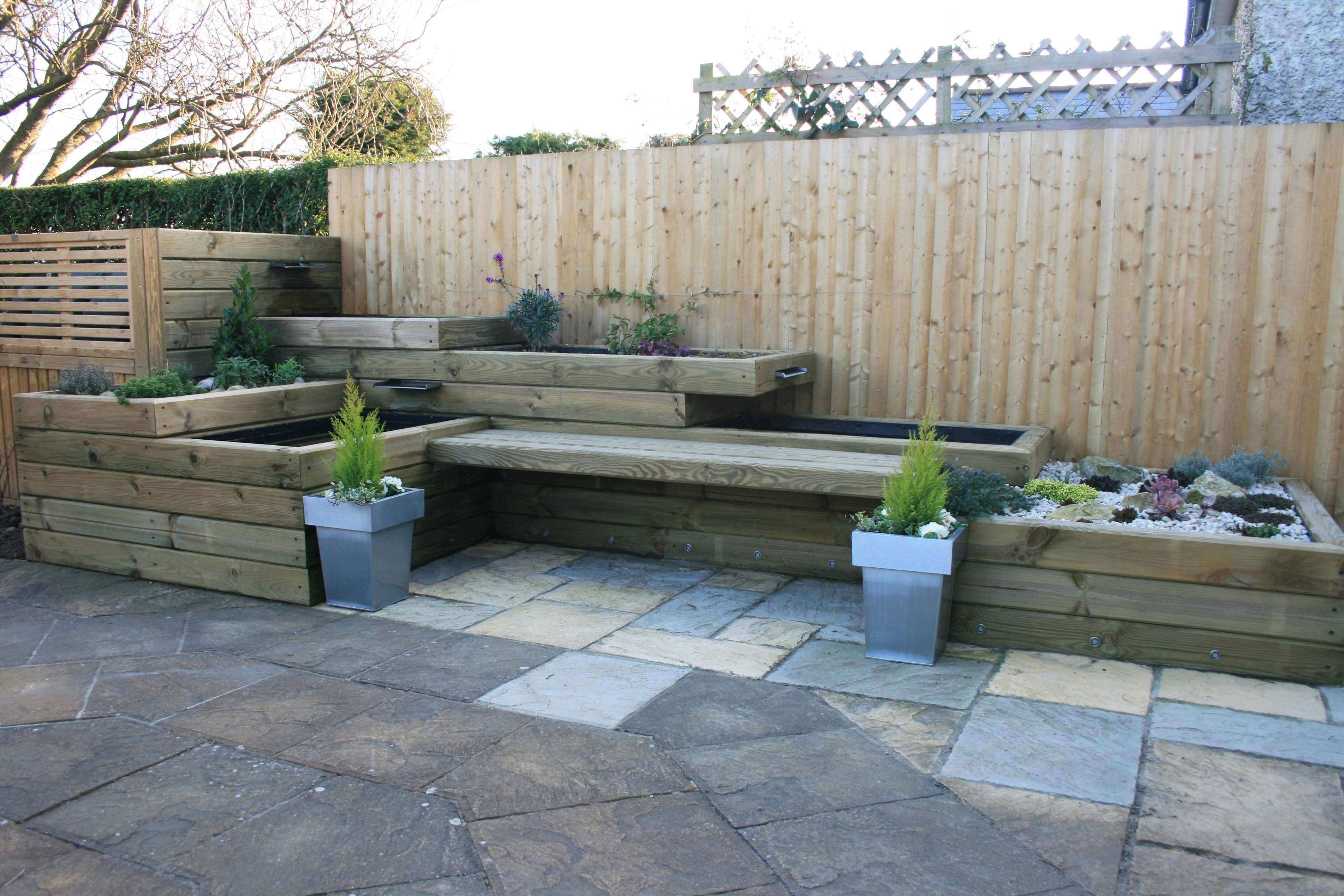 completed garden feature using landscape timbers
