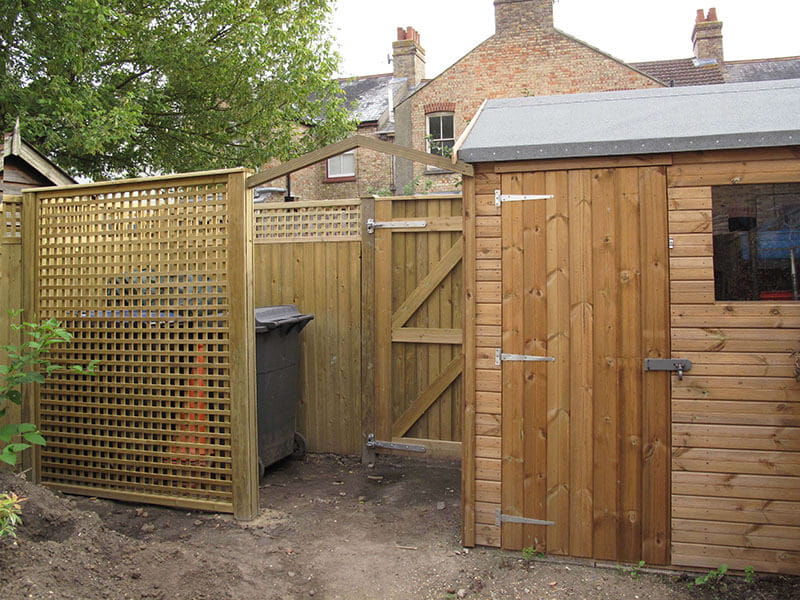 Lattice trellis panel hides bins