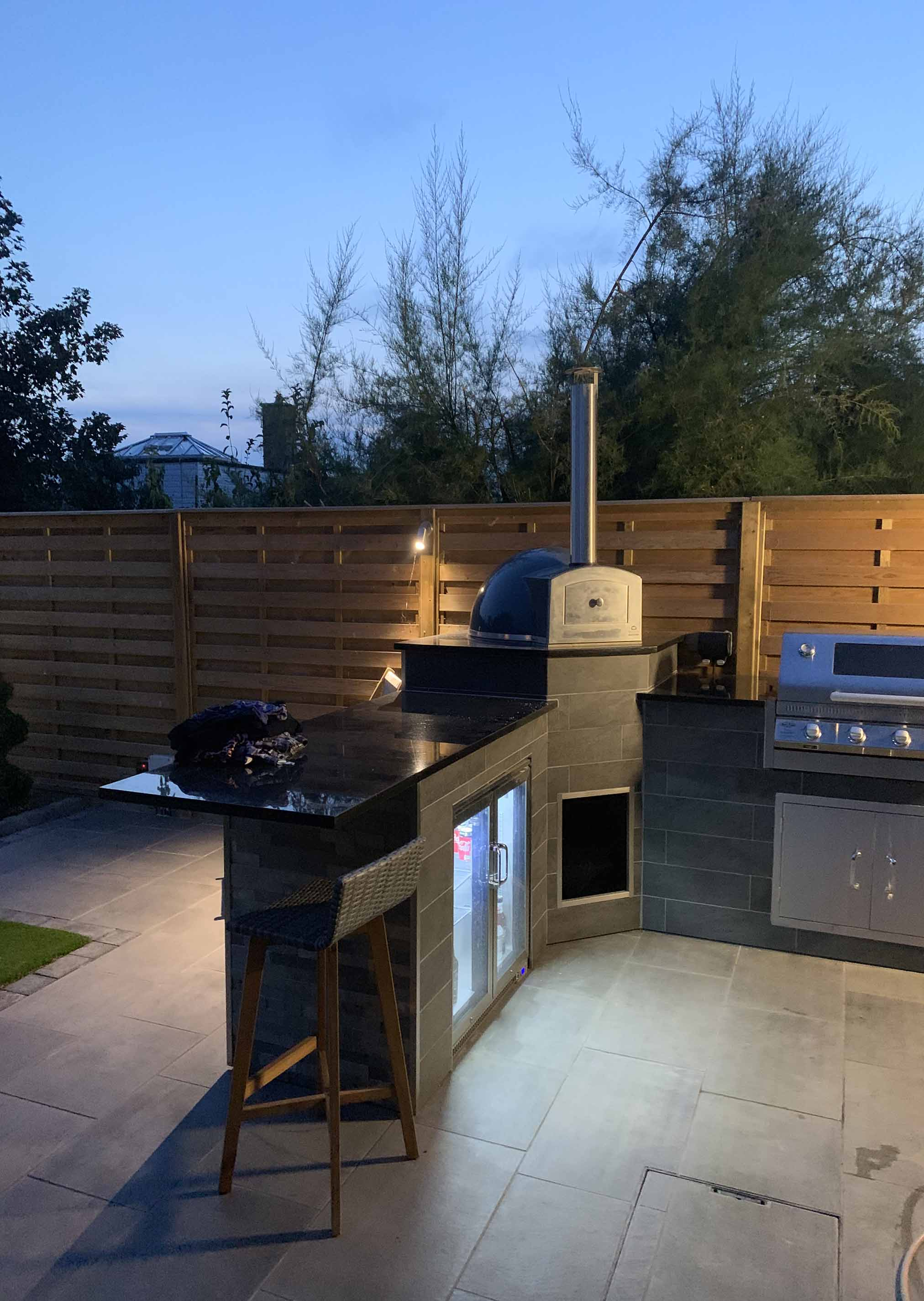 outdoor kitchen with fence panels