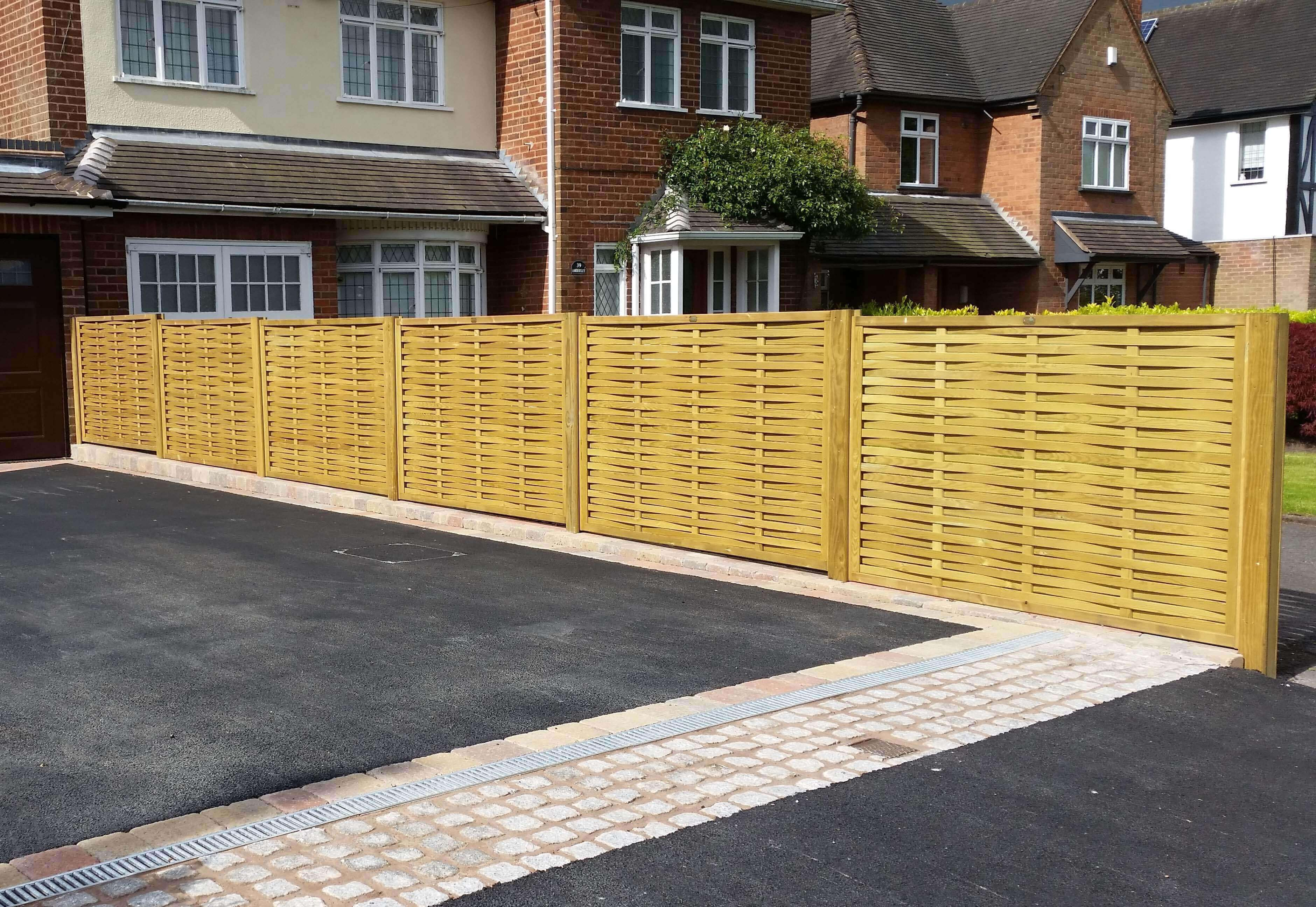 Driveway complete with woven fence panels