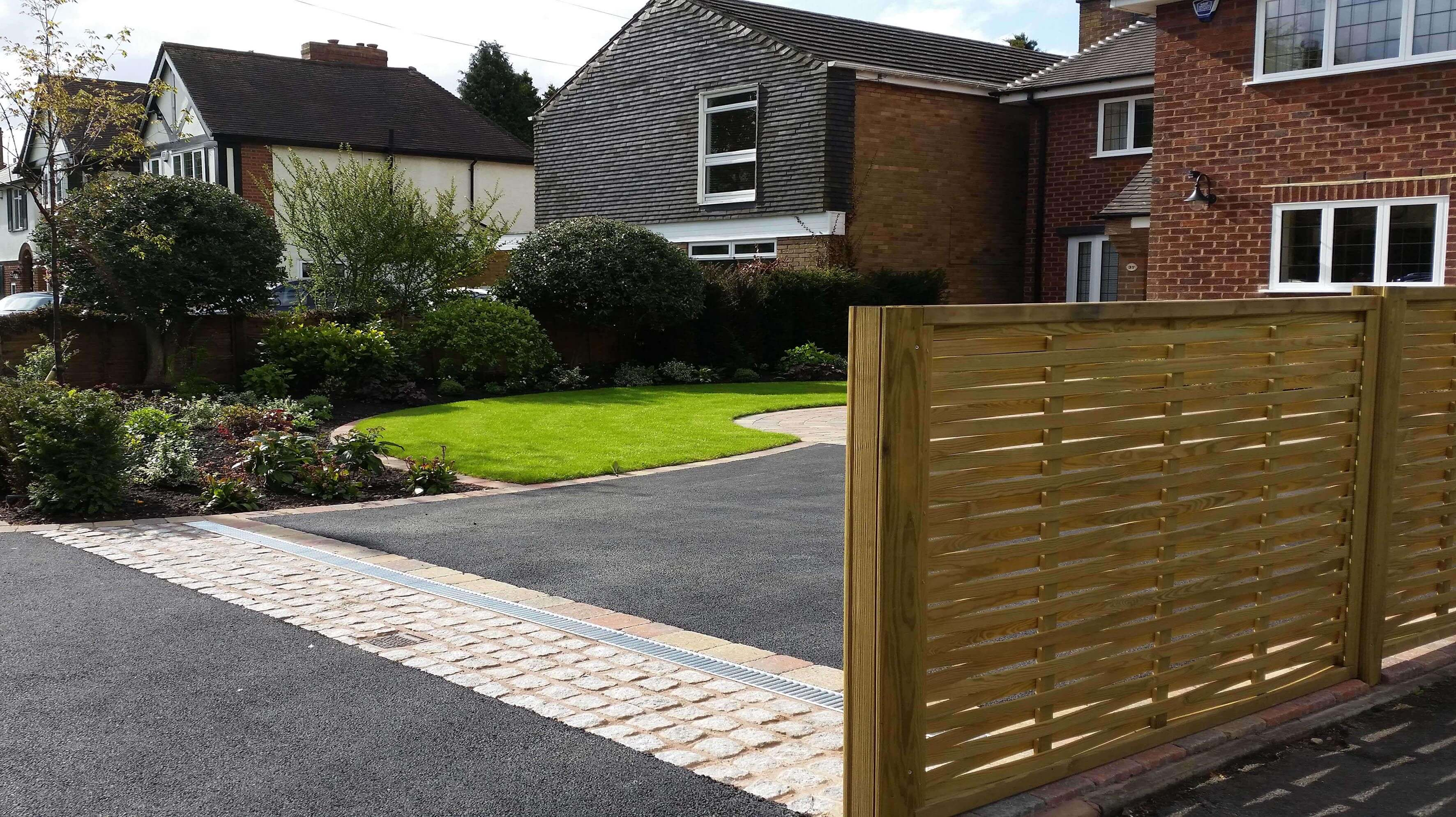 Finished driveway featuring Woven fence panels