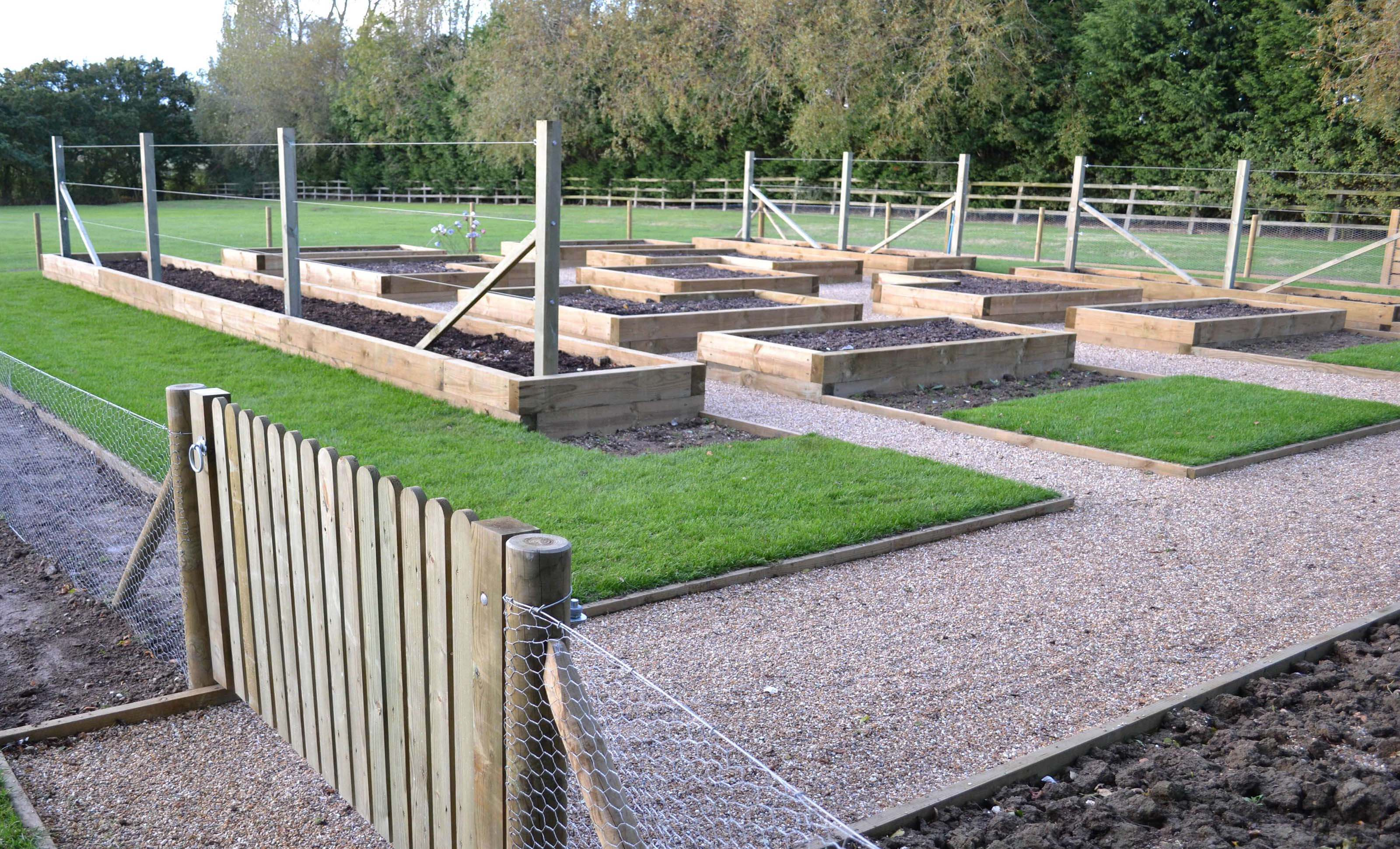 completed potager garden showing picket fence gate detail