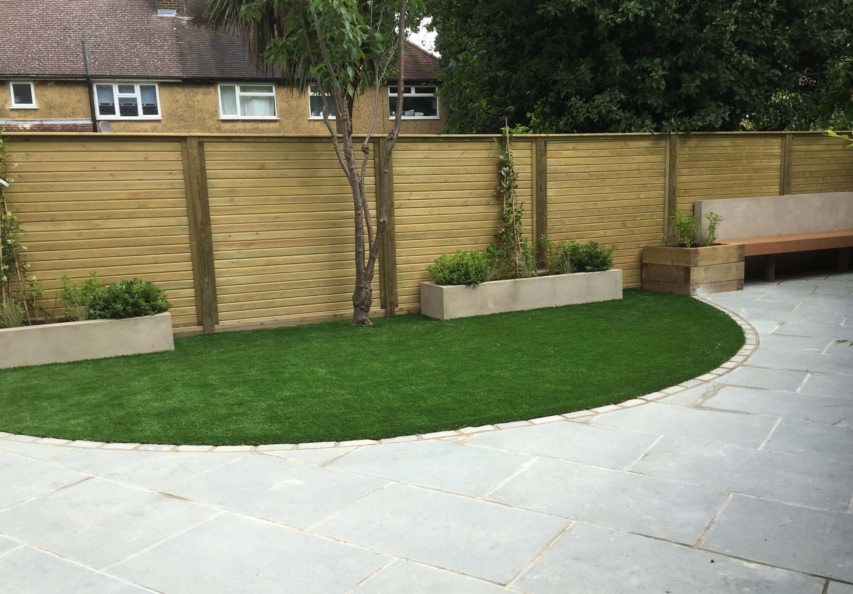artificial grass play area with secure fence