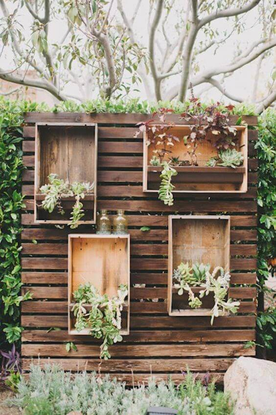 Plant boxes on chic fence