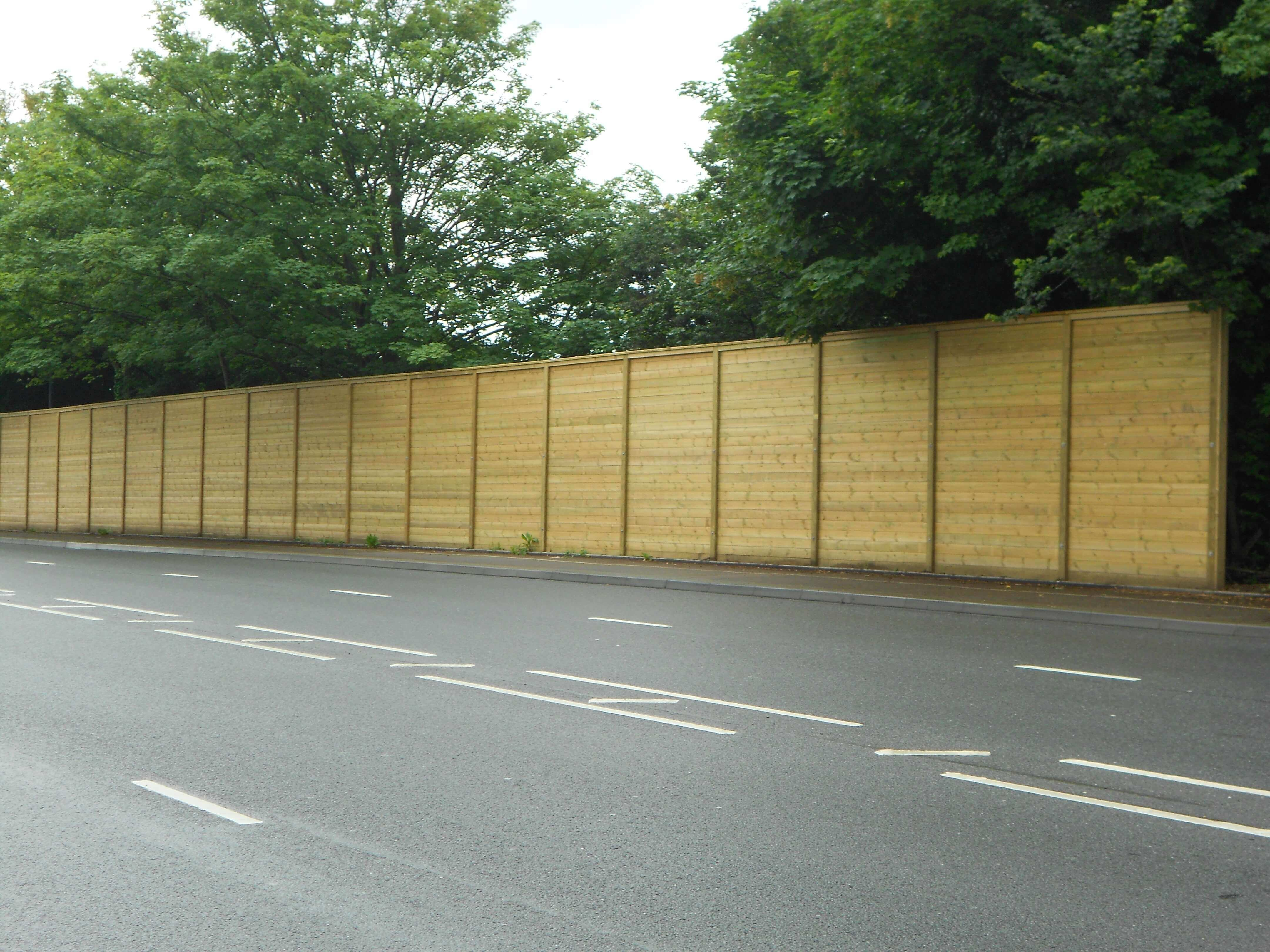 Acoustic fencing along road
