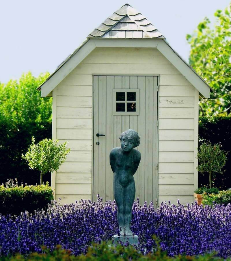 garden shed with statue