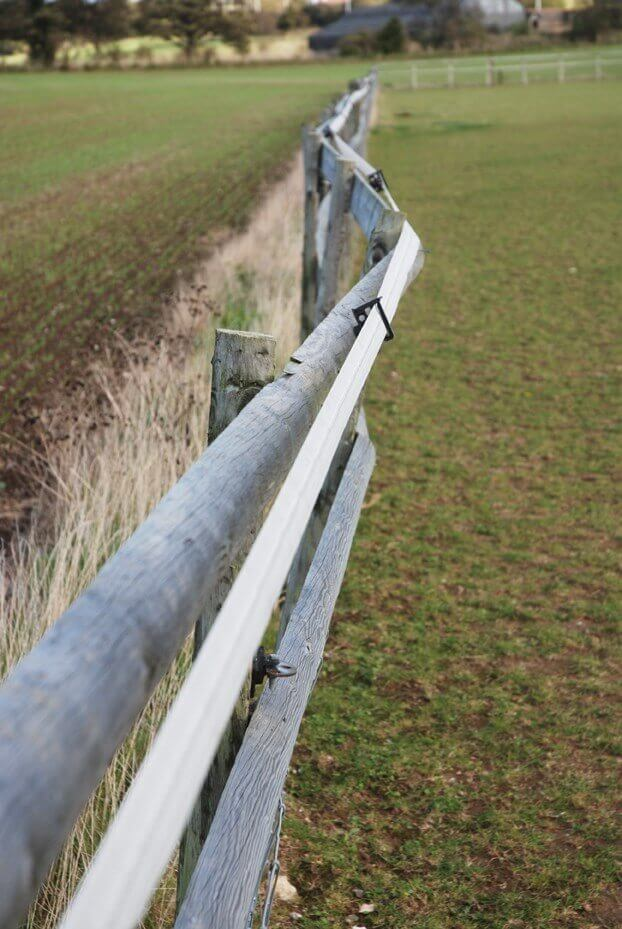 wavering fence caused by rot