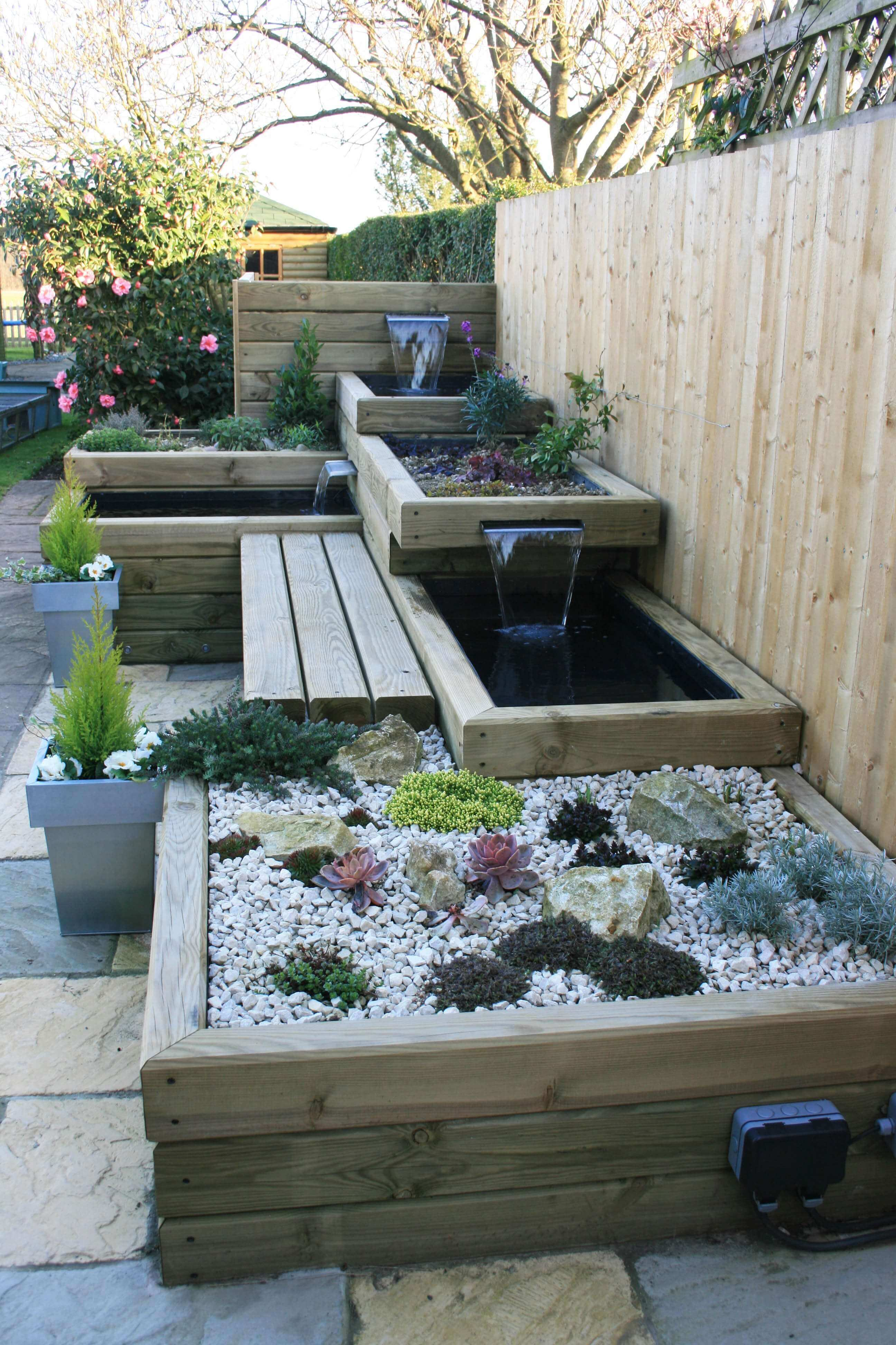garden with water features bench fencing panel garden design