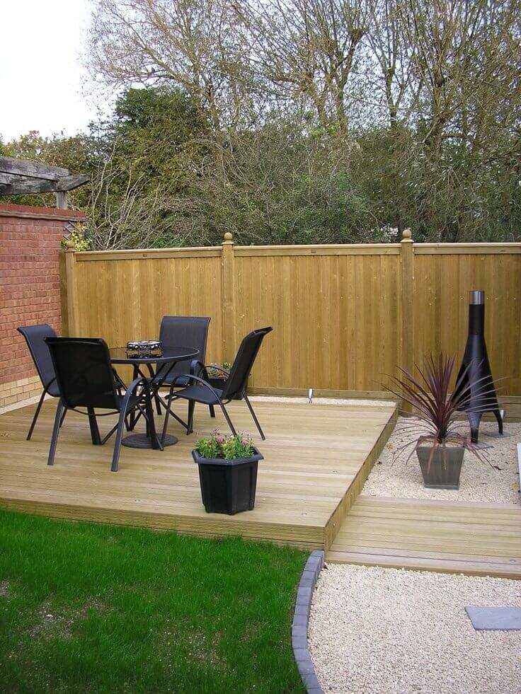 small decked area with fence panels