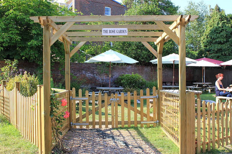 Create inviting entrances to gardens with a pergola