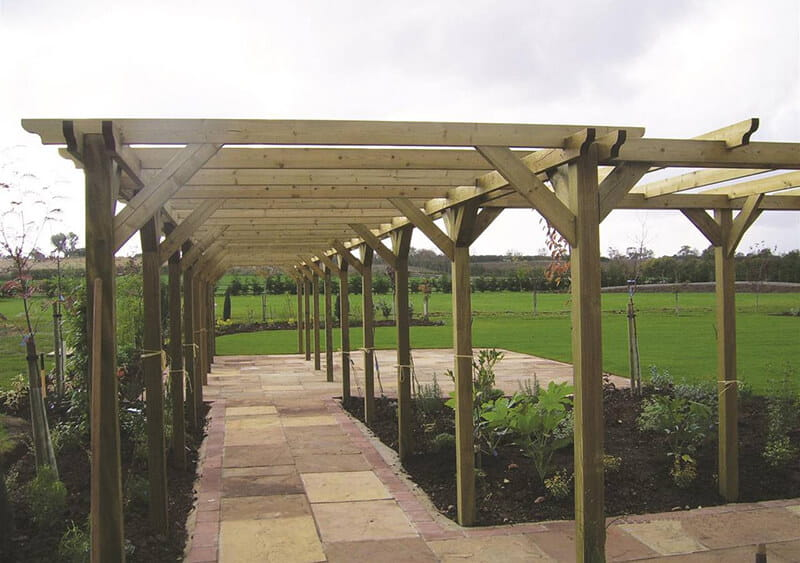 Install a pergola over a path to create a tunnel or walkway