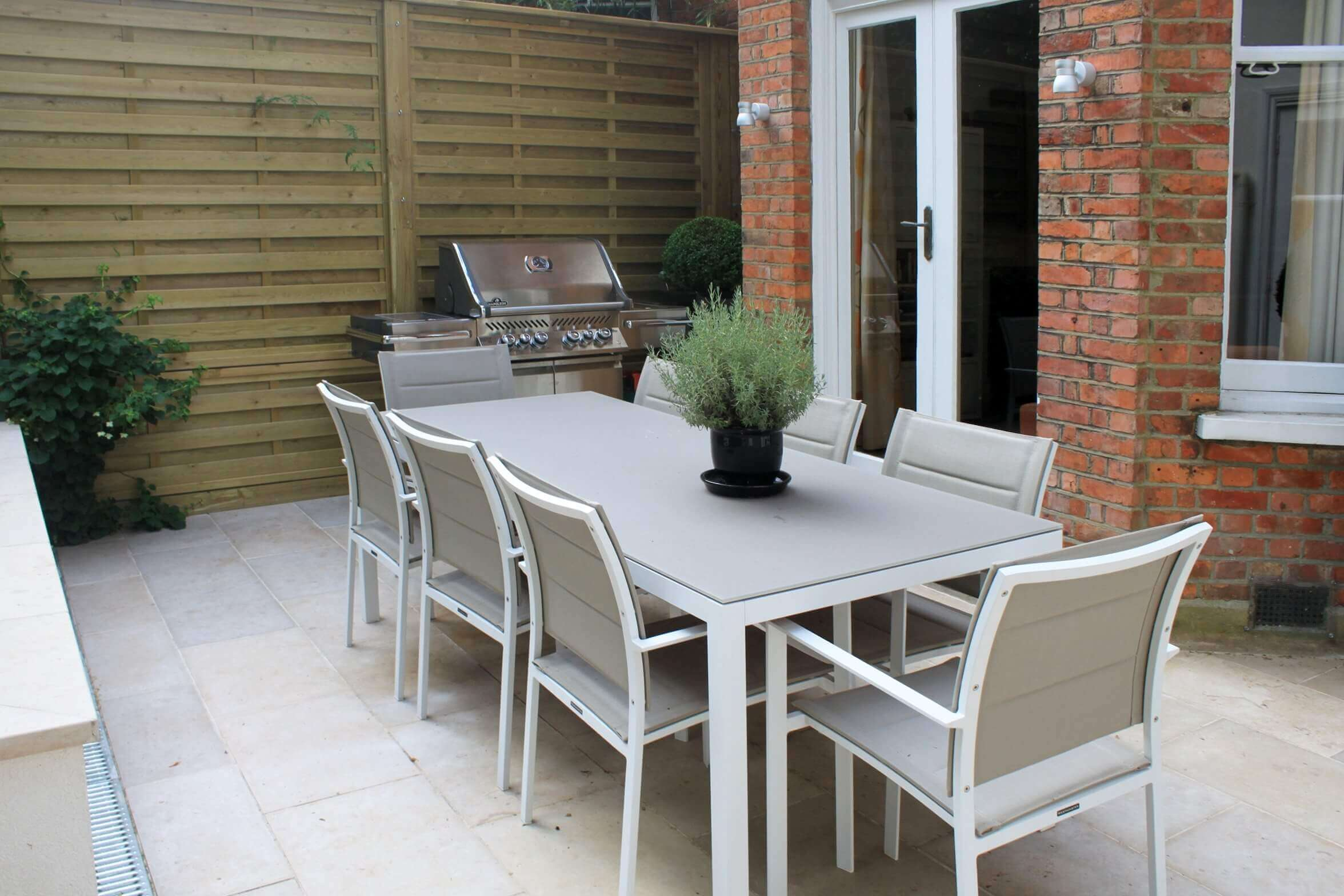 dining area on patio with Hit  Miss fence panels