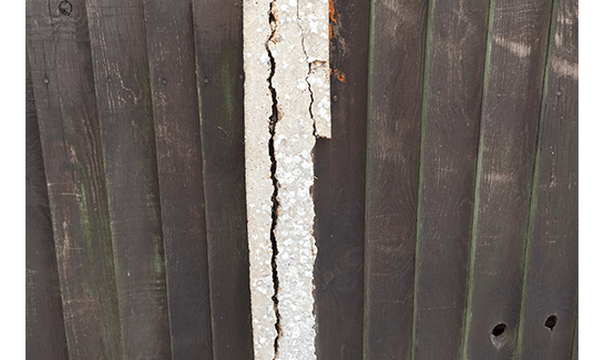 Cracked concrete post