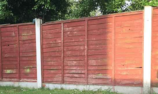 Fence panels in concrete posts