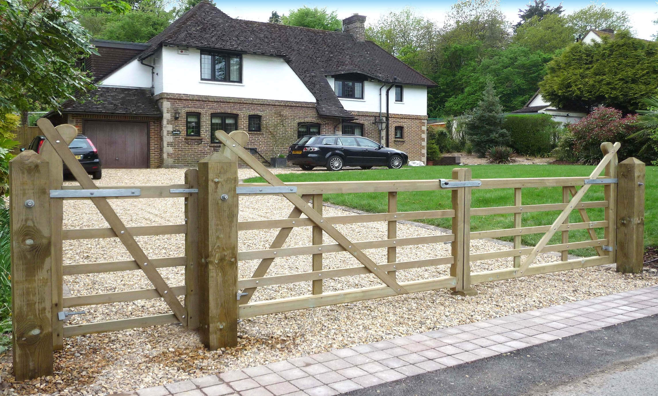Timber entrance gates on driveway
