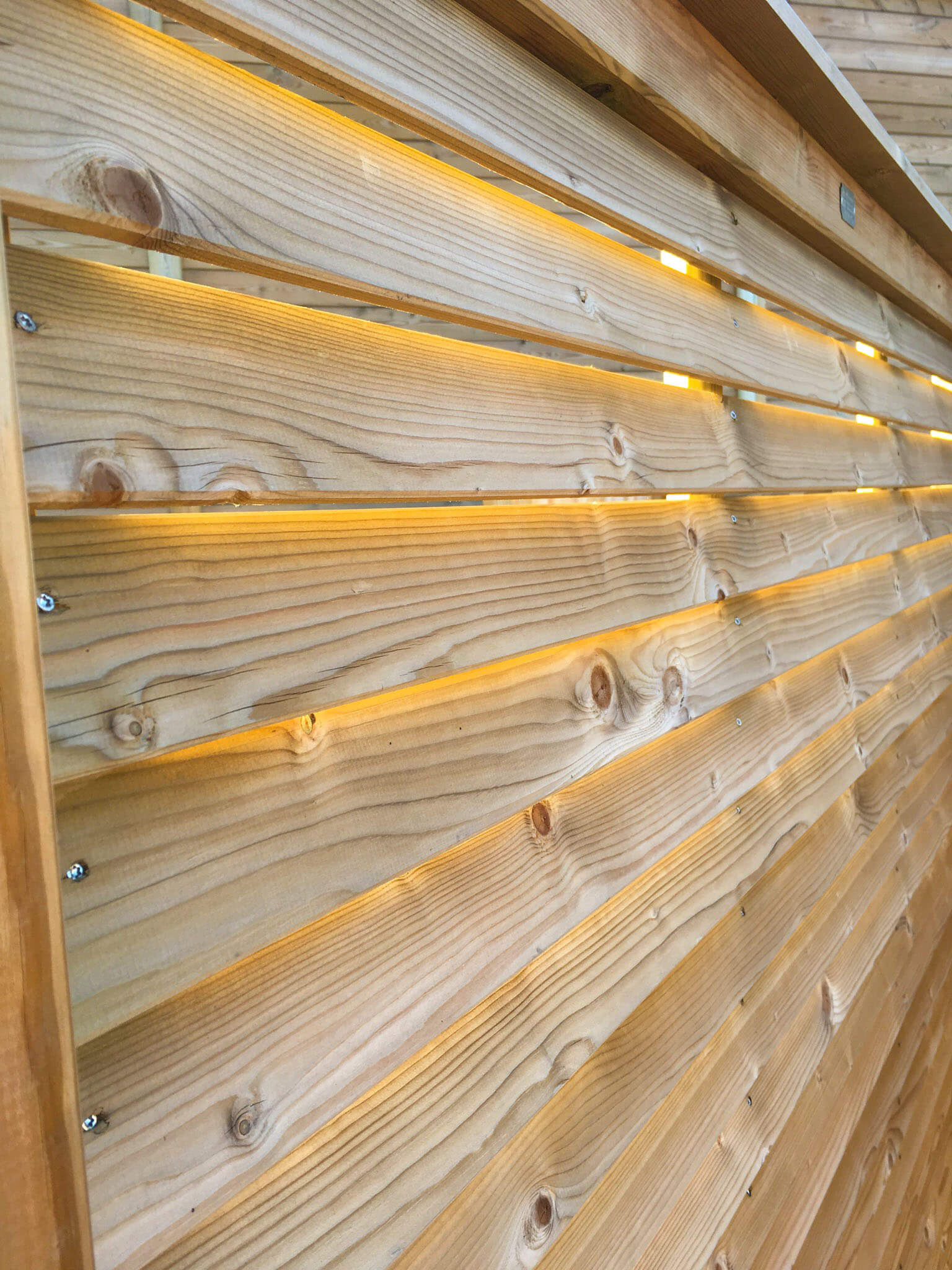 Slatted fencing lets light through