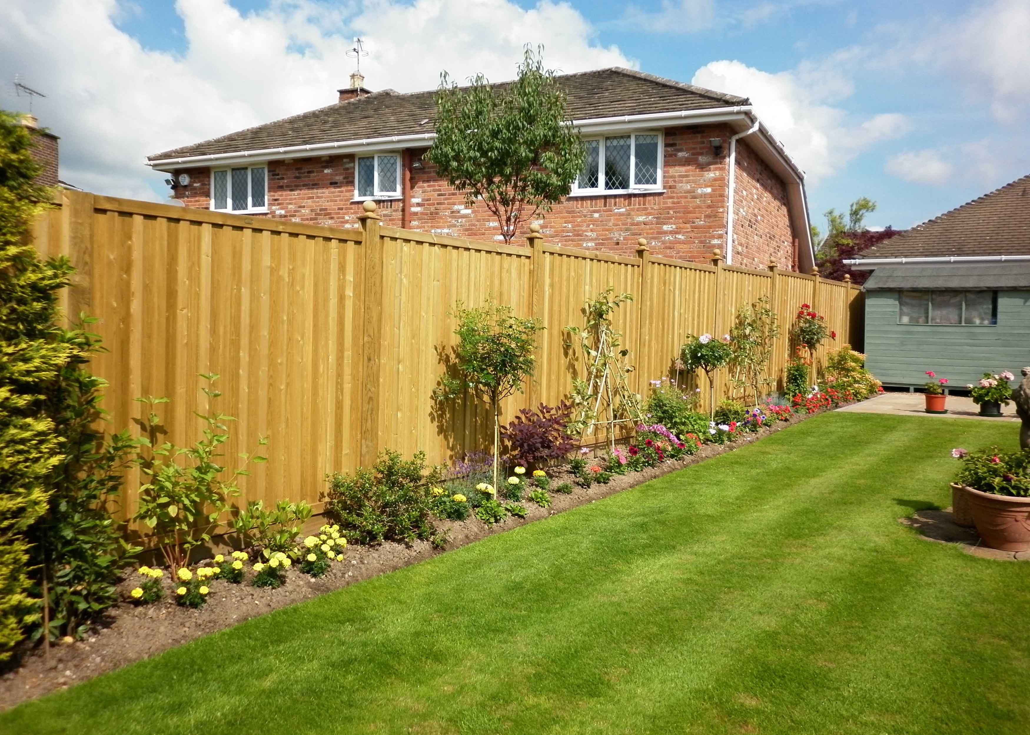 Solid fence panel in garden