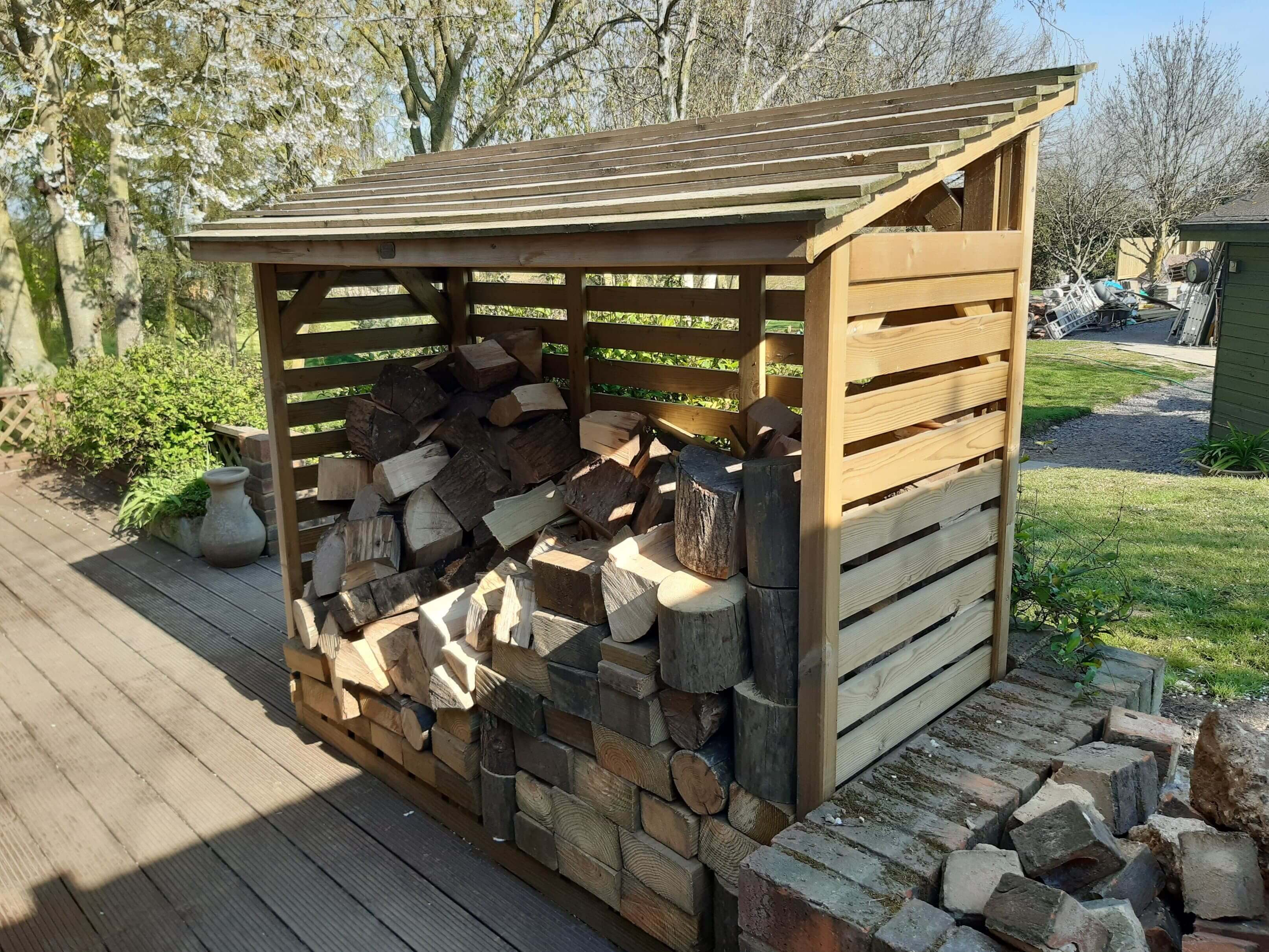 Timber roofed log store