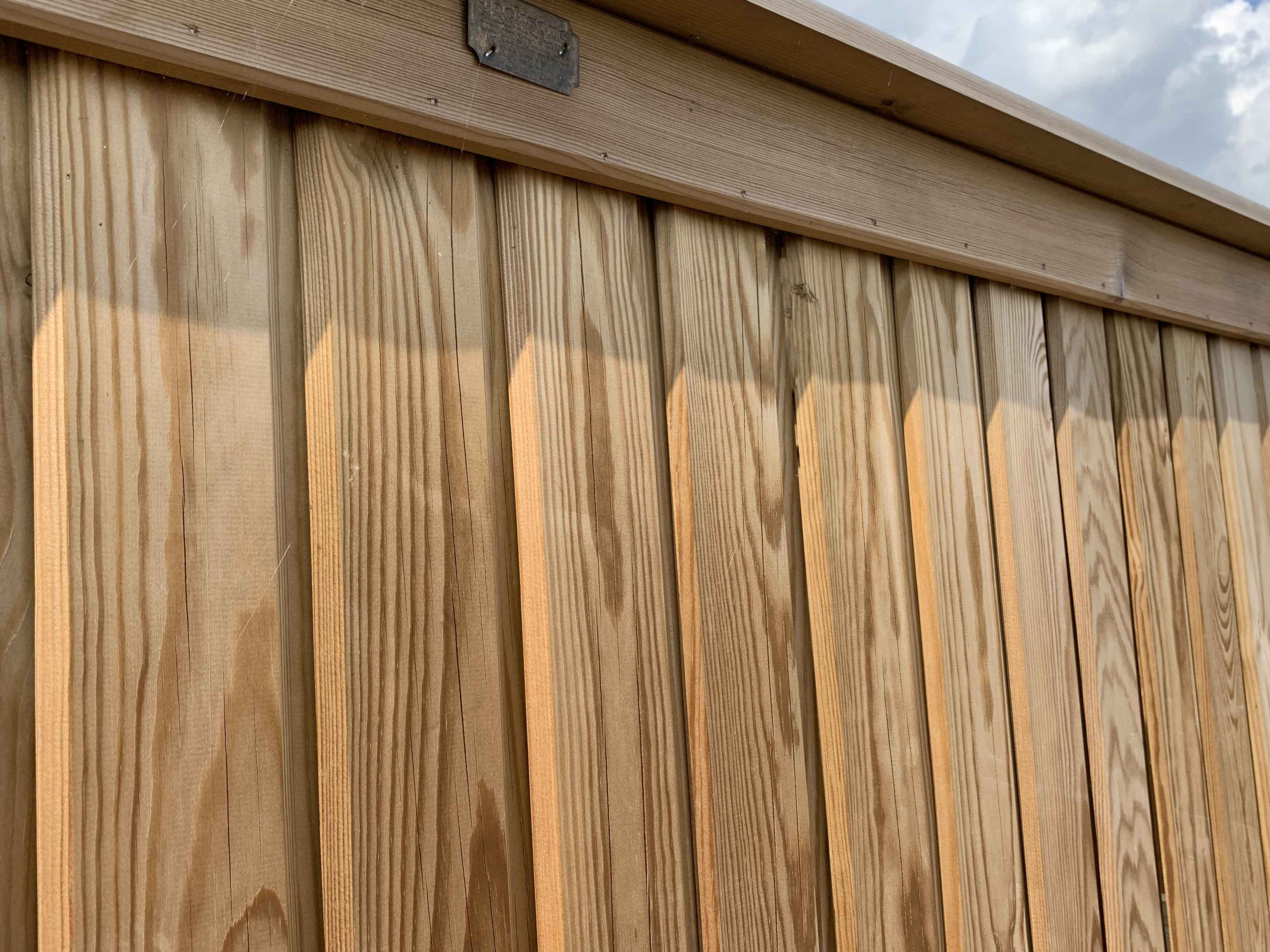 Vertical boarded fence panel