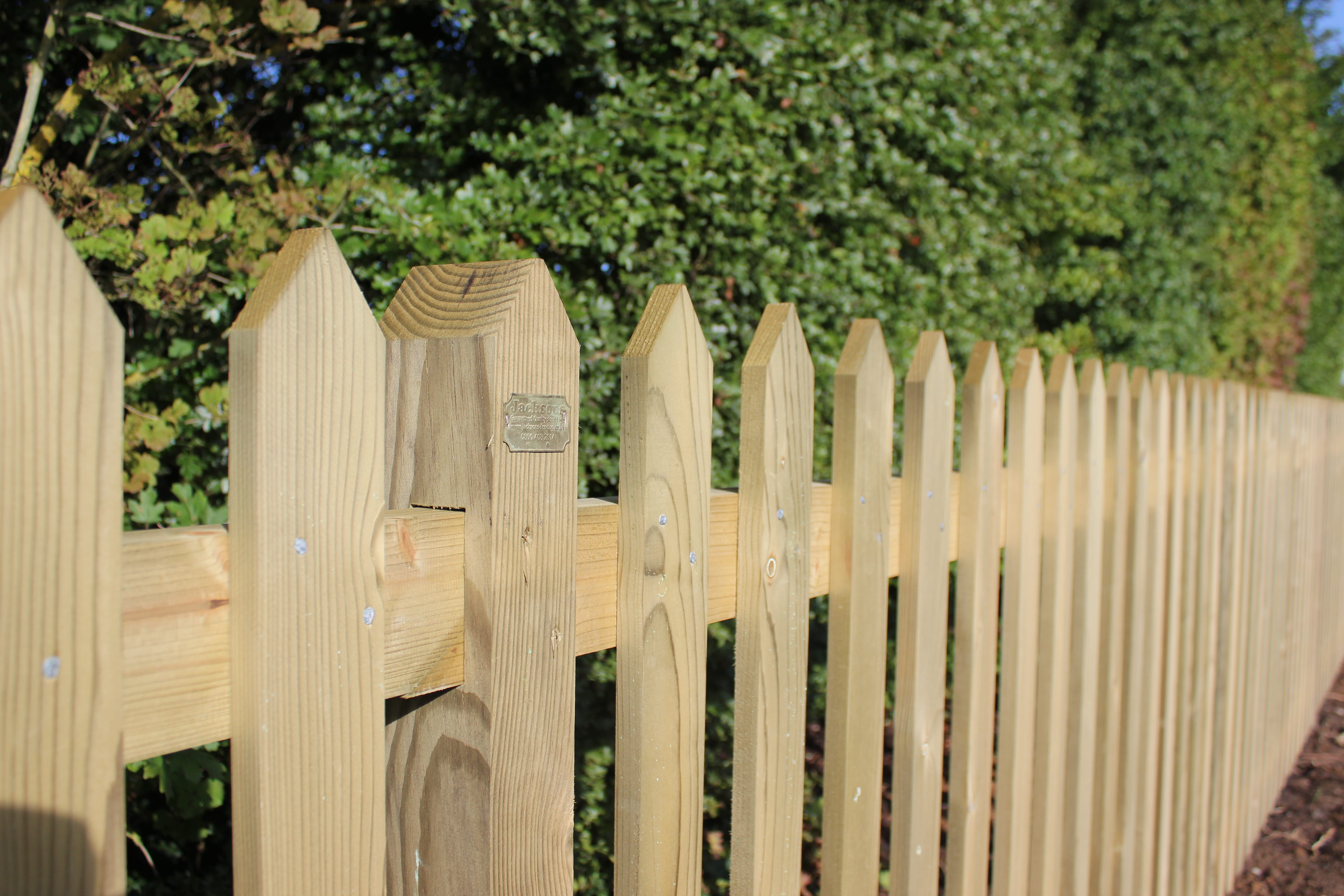 how to install a picket fence on slope best fence for